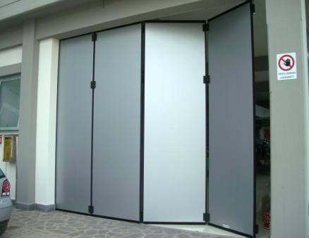 Portone industriale archivi centro service - Porte chiusura a libro ...